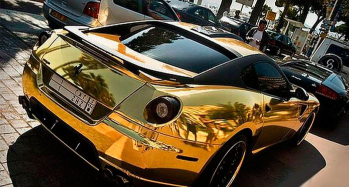 16 - Gold-plated cars parked on the street
